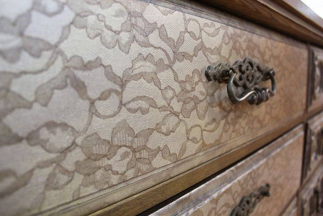 Put lace over a drawer/piece of wood and spray paint through it