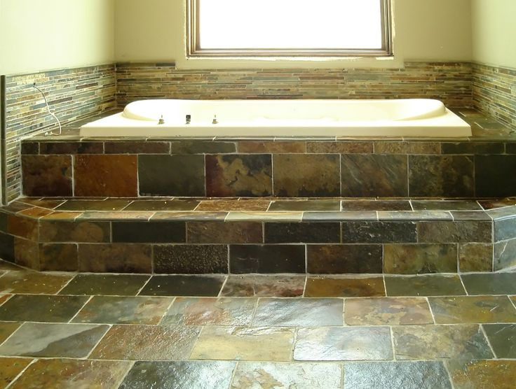 fantastic stone bathroom flooring ideas in small room with white planted bathtub and wide window