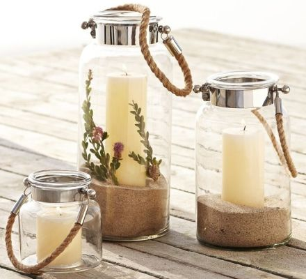 Pottery Barn Rope Handle Lanterns: http://www.completely-coastal.com/2013/04/nautical-rope-decorations.html Chic & nautical lanterns that you can fill with sand and shells!