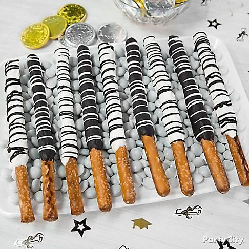 Drizzle on the class colors! Just melt Candy Melts® in both black & white, dip the pretzels, chill and drizzle with the opposite color! Easy, cute and super yummy!: