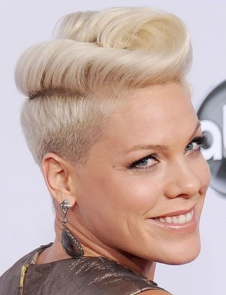 Pink's rockabilly-inspired flip is a festive way to dress up a short haircut. To get her look, backcomb hair to add height, comb over to the side, and roll the ends under. Use bobby pins in a shade that matches your hair so they aren't visible.