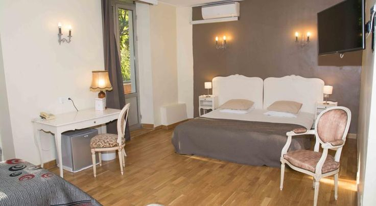 Empire Hôtel Nîmes Empire Hôtel is located in the heart of Nimes, 5 minutes' walk from Nimes Cathedral and 11 minutes' walk from the Roman Arènes de Nîmes. Free WiFi access is available.  Each guest room at Empire Hôtel also has a TV, a desk and a private bathroom.
