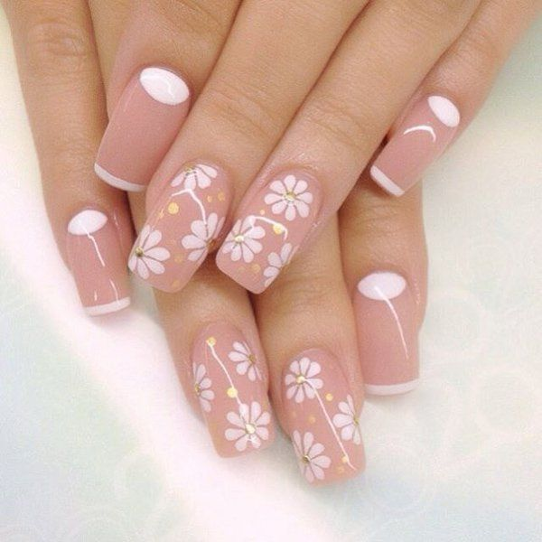 Wonderful flower inspired nude nail art design. Bring a cheery vibe to your nude nails by adding simple flowers in white nail polish along with gold sequins. You can also see a bit of French tip and cuticle paint in white.