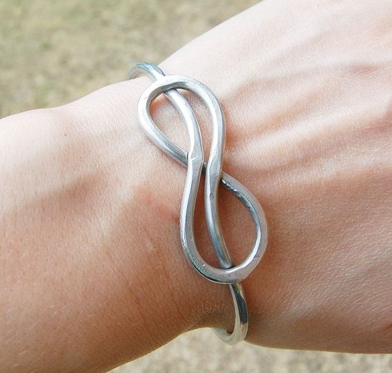 This solid piece bangle is handcrafted with very thick, sturdy 9 gauge aluminum wire. Please note that bangle bracelets slide over the