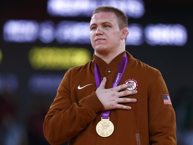 Jacob Stephen Varner of U.S. with his gold medal listens national anthem at the podium of the Men's 96Kg Freestyle wrestling at the ExCel venue during the London 2012 Olympic Games August 12, 2012.: Summer Olympics, 2012 Olympics, Olympics Games, Olympics Medal, Reuters Grigori Dukor, 2012 Summer, Olympics 2012, Reuter Grigori Dukor, 96Kg