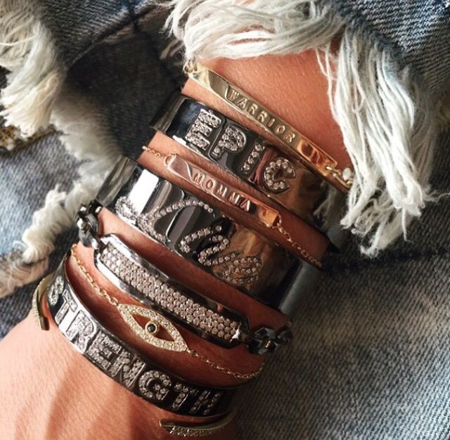 Stacked custom Jennifer Fisher cuffs and bracelets