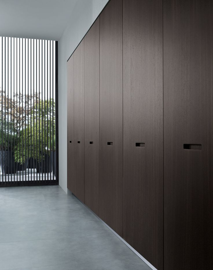 Tall unit with retractable doors in spessart oak.