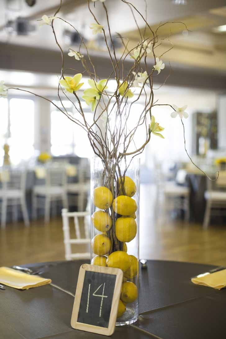 We love brightening up gray decor with a pop of color. Yellow is a hue that looks fabulous with shades of gray! #weddingdecor #grayandyellow #weddings: Weddings Design, Simple Centerpieces, Lemon Centerpieces, Yellow Weddings Decoration, Centers Piece, Yellow Centerpieces, Branches, Gray Yellow, Chalkboards Centerpieces