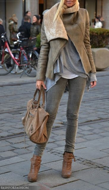 stone coloured jacket with a cream wool scarf over a loose dove grey top with skinnys ankle boots and a brown leather bag.