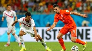 Robin van Persie of the Netherlands and Giancarlo Gonzalez of Costa Rica compete for the ball