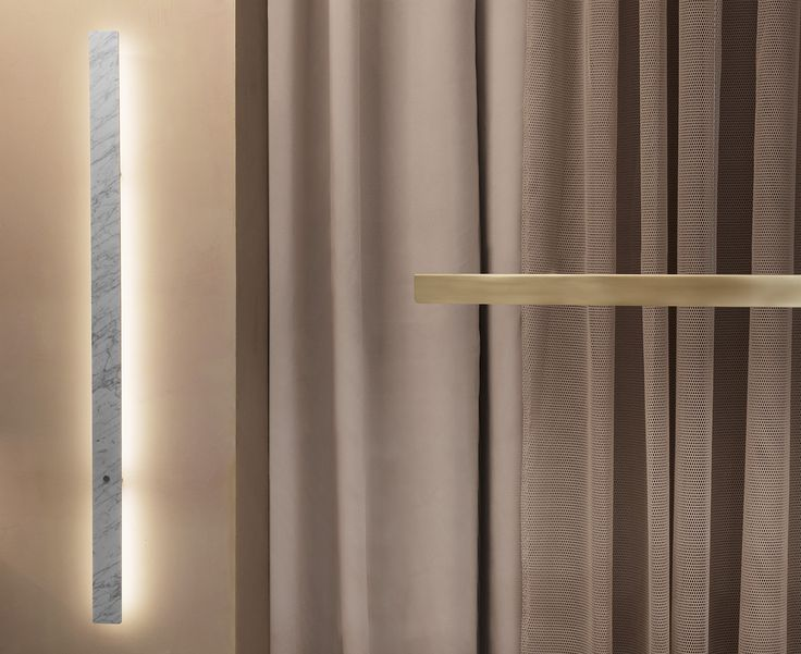 Anour I-Model brushed brass and DIVAR wall lamp