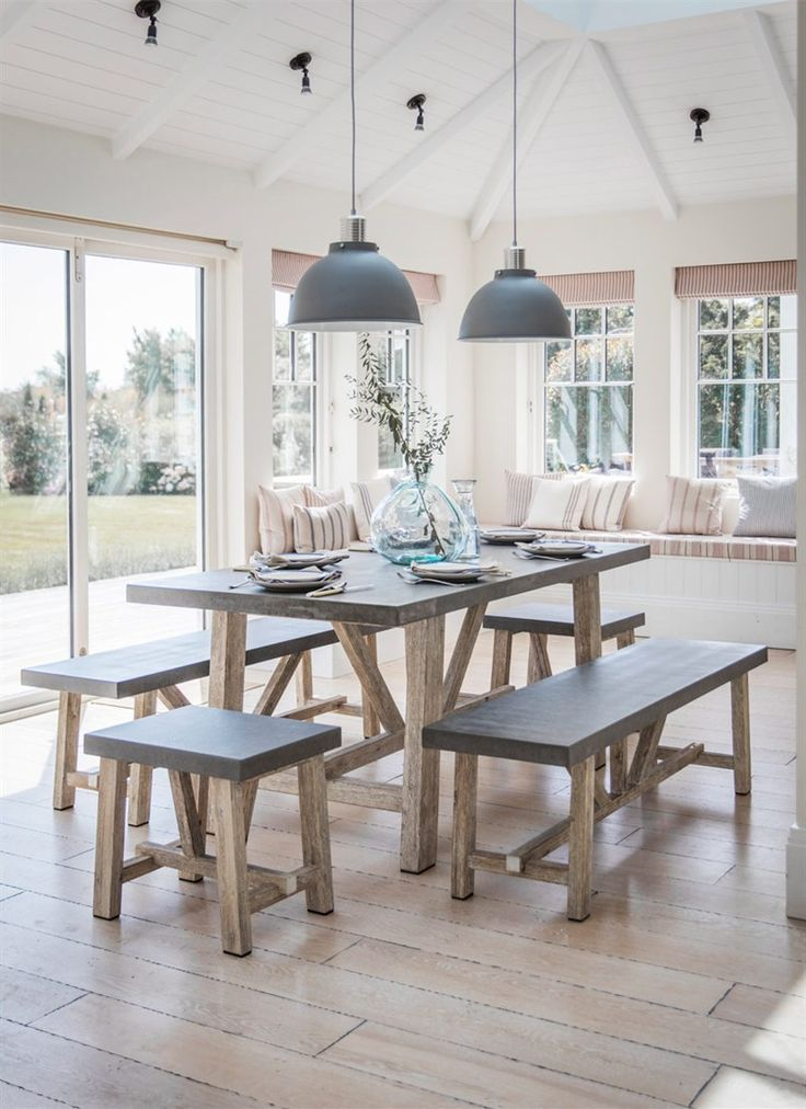 The Smaller Chilson Table and Bench Set is crafted in Cement Fibre with Acacia Wood Legs, perfect for indoor or outdoor use ... from Garden Trading