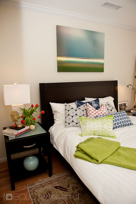 how to style a bed a mix of patterned pillows accent the original artwork by @Pamela Culligan Bolig