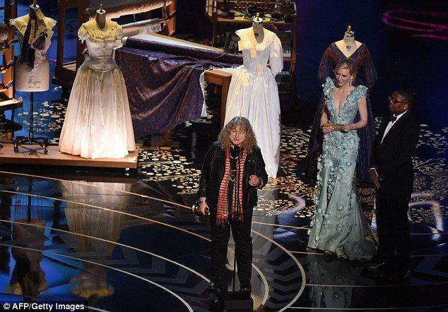 British costume designer Jenny Beavan accepts her award for Mad Max: Fury Road on stage la...