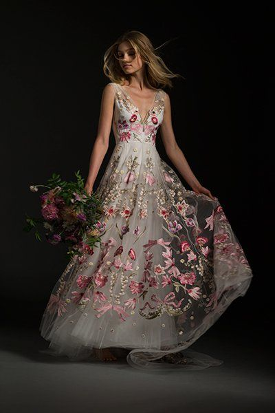"Can't picture yourself walking down the aisle in a traditional white wedding dress? Temperley Bridal's ""Bibi"" style is a vibrant explosion of color, with embroidered pink and purple English flowers and touches of greenery.Related: Gorgeous Brides in Non-Traditional Wedding Dresses"