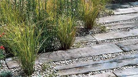 Materials for Walkways and Paths | Drought tolerant plants with railroad tie borders and gravel