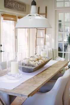 Farmhouse Style Sunroom Dining with Wood Table, Linen Charis, White Metal Pendant, Wood Ladder and more in this Stunning Neutral Home Tour - Life On Virginia Street
