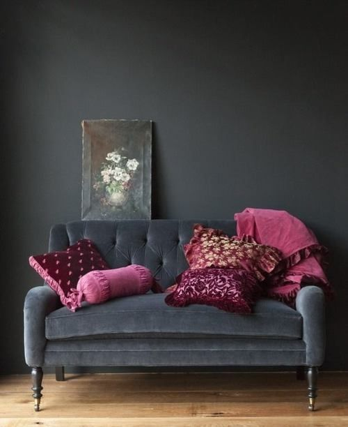 gray couch with gray walls with hot pink
