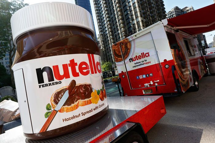 To share their love for the snack brand, guests posed with Nutella props at photo stations.  Photo: Brian Ach/AP Images for Nutella
