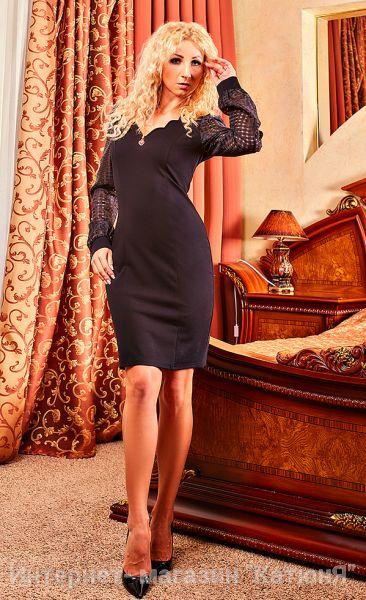 Соблазнительное осеннее платье специально для девушек занимающих руководящие должности. Идеально подходит для офисной работы и повседневной городской жизни. Отличается яркой и необычной расцветкой (полотно – коричневое, рукава цвета мяты). Фасон полуприлегающий с V-образным вырезом горловины. На