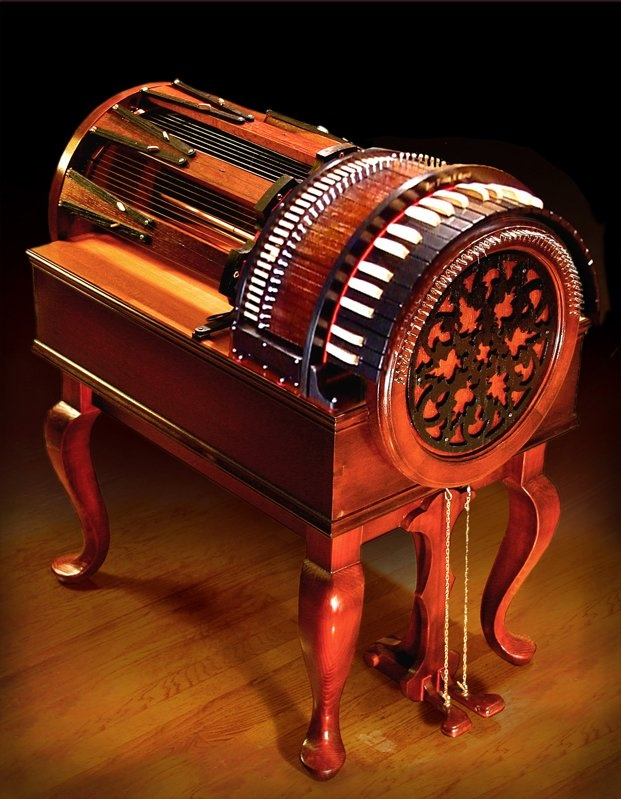One of the most beautiful instruments ever made. Yes, it's a modern instrument. It's a Wheel Harp - a modern variation of a Hurdy Gurdy.