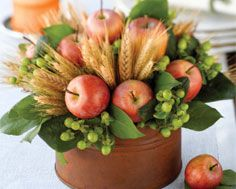 Easy and inexpensive for a florist could even make these fake yourself in a big verison for the alter area with tall candles  DIY Fall Centerpiece