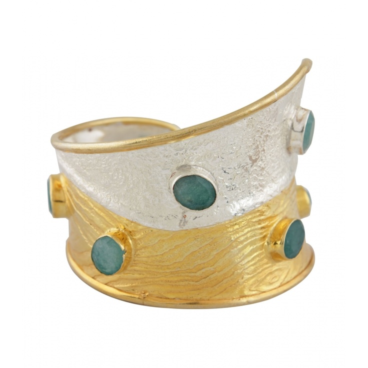 Crazy Turquoise Golden Cuff. This golden delight has a touch of turquoise! The unique combination of gold-plated Sterling Silver & Cubic Zircon results in this special cuff. Its exclusive design and sheer elegance will make you stand out in a crowd. $234