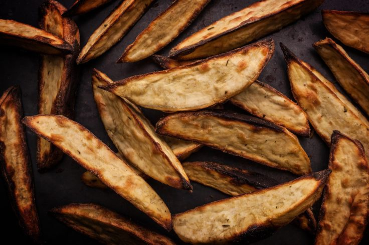 An easy, healthy recipe for roasted sweet potato wedges seasoned with ground mustard, fresh rosemary, and salt.
