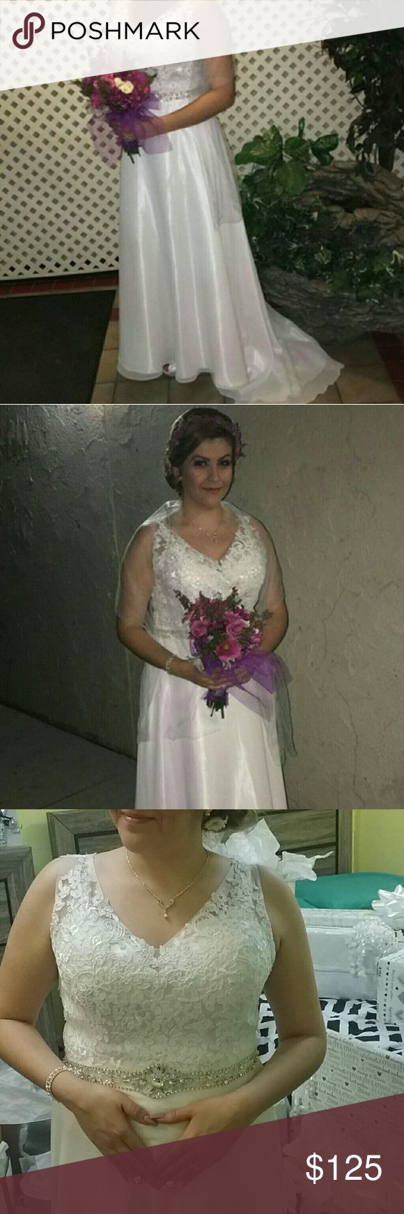"""Formal Wedding Dress Top Laced with beads above Waist all around. Used Once Altrated to fit 5""""8 tall with heels. Zips up from the back. Fits like a Size 10-12. Basically its a Large. Waist 28-30. Bra cups fits 34 B and C. Dress is flowy. Silky and Satin Material. V-neck. Has a Short Court train. No Trades or Price Change. No stains great condition. Dresses Wedding"""