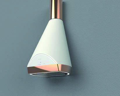 Students of the Politecnico di Milano have furthered their education at Faber. The result is Kiara, an out of the box hood with a country style design, revised and updated with slightly rounded shapes that meet sharp lines at the edges, and are highlighted by copper components. Its shape is both classical and contemporary, clearly functional and again emphasising the high performance of Faber products.
