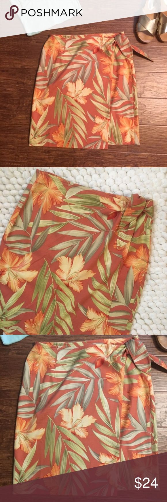 """Tommy Bahama floral wrap skirt size small Never worn. Beautiful tommy bahama tropical print silk wrap skirt. Ties at side. 2 inner buttons to adjust. Just above the knee. Perfect vacation item! Coral with splashes of green and yellow. Size small.  🚫MEASUREMENTS LAYING FLAT: Waist: 15"""" Hips: 20"""" Length: 21"""" The measurements are tied at the side and laying flat and also there are two inner buttons, and this measurement was taken buttoned on the smaller adjustment.        040817 Tommy Bahama…"""