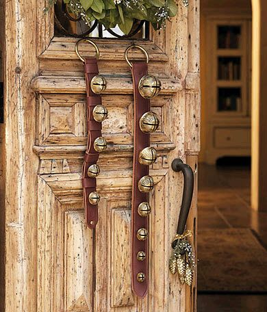 Notice the pinecone motif ornaments on The door handle. Love the reindeer collars can't see the wreath, but bet it's simply elegantly natural. Love the door.