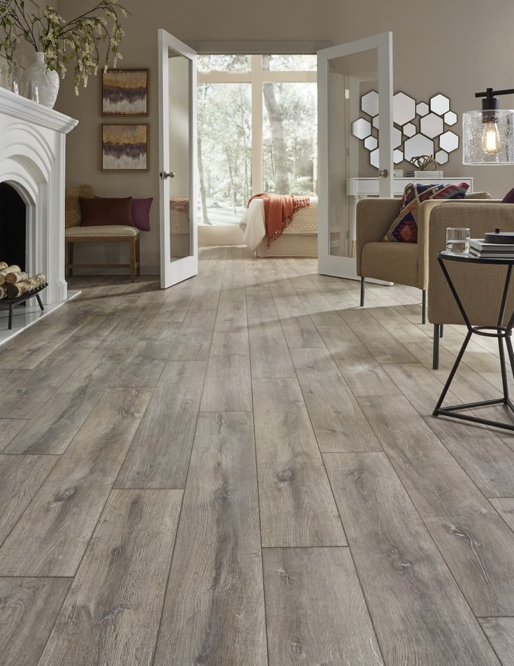 "A European white oak look that evokes images of gently time-worn flooring in French chateaus, Mannington's Blacksmith Oak laminate (color ""Anvil"" shown) is a sophisticated rustic with rich color and grain, and beautiful color play from plank-to-plank. The embossed in register planks are 8-inches wide: http://www.mannington.com/Residential/Laminate/Restoration-Collection/Blacksmith-Oak/28302"
