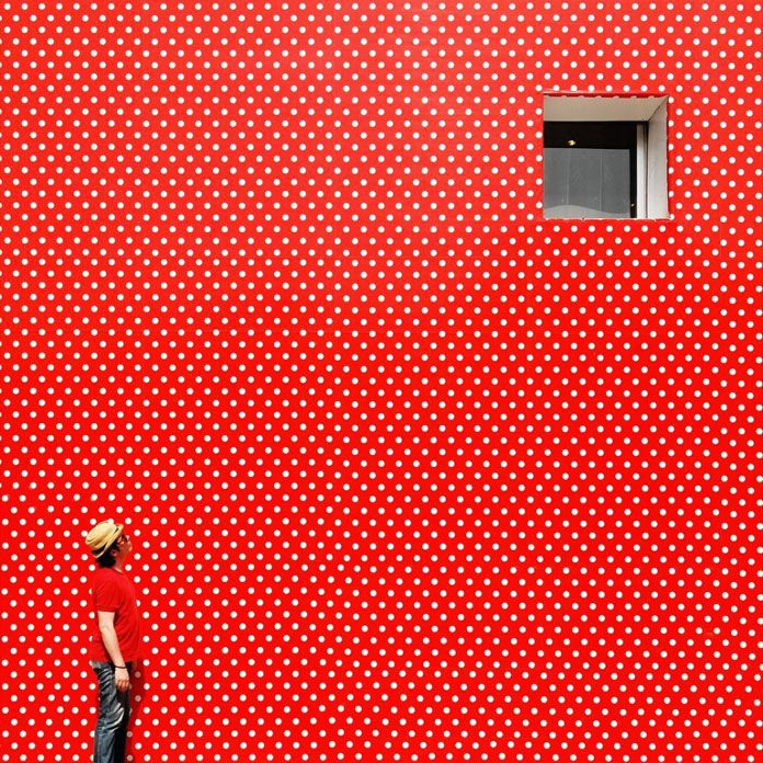 Red wall with white dots by Yener Torun