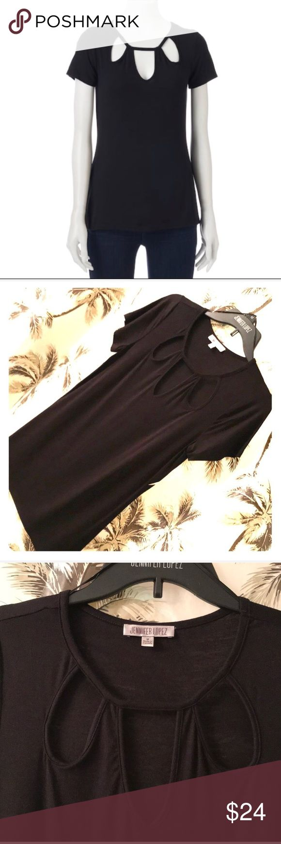 Jennifer Lopez black key hole tee NWT Jennifer Lopez fitted black tee with triple key hole at neck line. Super sexy with skinny jeans and heels or boots or for a sophisticated look wear with a pencil skirt and blazer. 95% rayon 5% spandex. Ultra stretchy and very form fitting. Machine wash cold and dry flat. Jennifer Lopez Tops Tees - Short Sleeve