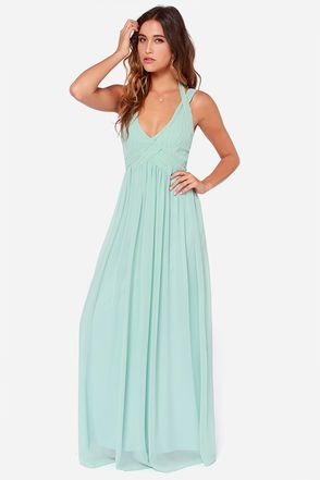"""LuLu*s Exclusive! The Strike a Minerva Mint Green Maxi Dress is bound to hit a high note and win its way into your good graces in no time at all! This chiffon dress features a highly pintucked triangle bodice, with double shoulder straps emerging from the peaks, and wrapping above your shoulders and behind your neck with a chic two-button closure. The skirt gathers at the waist and reaches down to an elegant maxi length. Hidden back zipper/clasp closure. Fully lined. Model is 5'8"""" and…"""