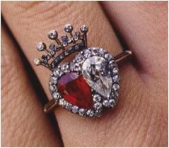 Earl Spencer gave this dual ruby and diamond ring topped with a crown to his first wife, Victoria Lockwood. Queen Victoria received a simila...