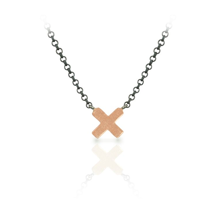 Dainty Rose Gold Cross Necklace with blackened silver integrated chain Small Rose Gold Cross Necklace – cross is cast in solid 9 carat rose gold and sandblasted to a matte finish. Blackened silver belcher chain is integrated and is adjustable from 45cm (about 17 1/2 inches) to 43cm (17 inches). A lovely solid silver signature Scarab charm terminates the chain at the back of the neck. Designed to be worn en-masse with the Yellow Gold Heart Necklace, or Rose Gold Heart Necklace – or simply on…