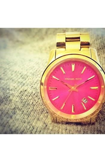 Michael Kors gold watch with a pink face. Perfection.