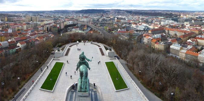 View from Vítkov Hill - Žižkov on the left hand side. Žižkov takes its name from Hussite warrior Jan Žižka, whose equestrian statue, on the edge of Vítkov Hill, looms menacingly over Žižkov and Karlín.