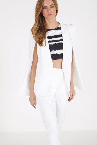Lydia Bright wears White Collarless Cape Blazer by Lavish Alice