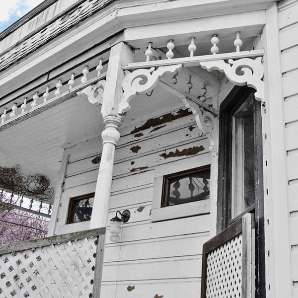 folk victorian cottage exterior with porch brackets, spindlework, portland oregon, save this old house