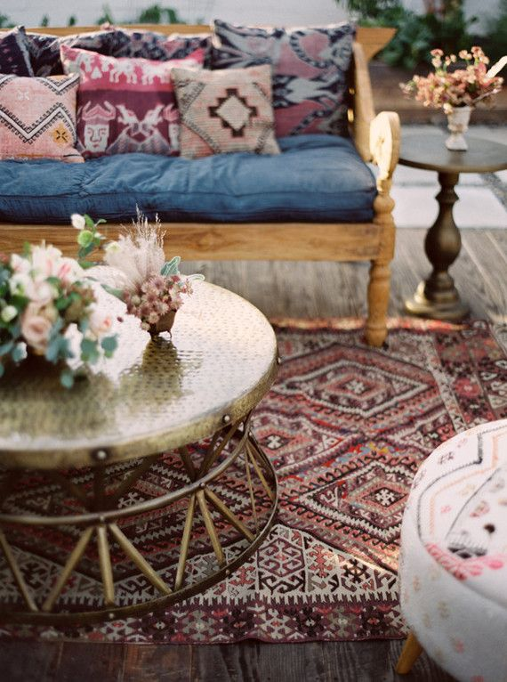 Ethnic cushions and pillows. Kilim carpets tapestry and mixtures of unusual colours for a sweet little boho wedding lounge!