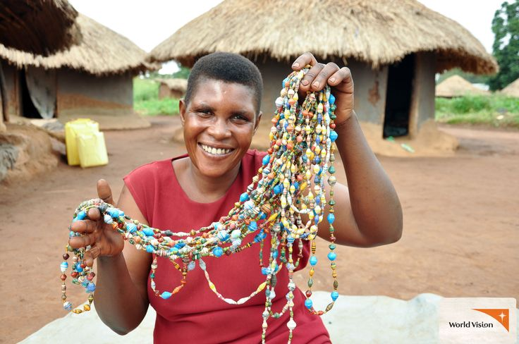 Margaret from #Uganda shows the #paper #bead chains she has made. Margaret is part of a women's group that make and sell the beads to earn extra #income. Photo by Simon Peter Esaku, #WorldVision