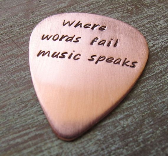 Personalized Hand Stamped Custom Copper Guitar Pick with Leather Case - Gift for Him Musician Dad Brother Rock Star. $33.00, via Etsy.