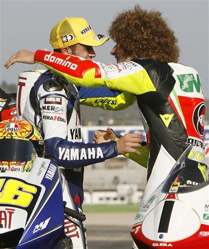 Valentino Rossi (left) and Marco Simoncelli (right) Ciao #Sic58
