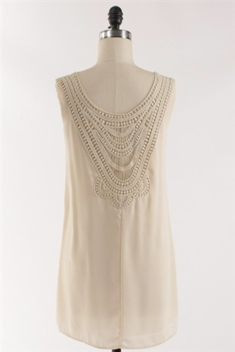 his scoop neck dress has a beautiful crochet back detail. Simple but sexy... could had a fun belt for a little more style. Of course we say just add a pair of tan legs and hot cowgirl boots. And your the envy of that summer get together.  Made in the USA. $49 FREE SHIPPING