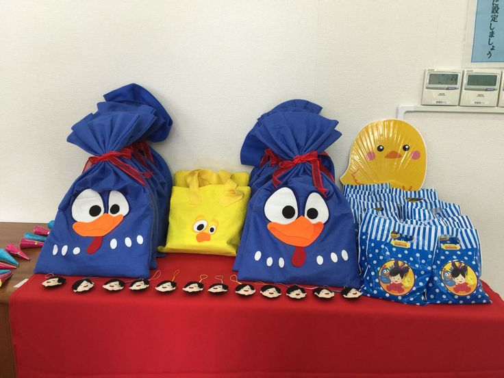 Customized Surprise Bags with Toys and Snacks, Baby Items and Hand-Made Key Holder Party Favors.