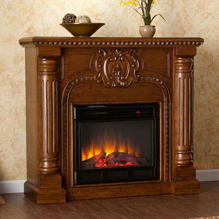 Add a gorgeous focal point to your room with this hand-carved freestanding electric  fireplace - 17 Best Images About Electric Fireplaces On Pinterest Electric