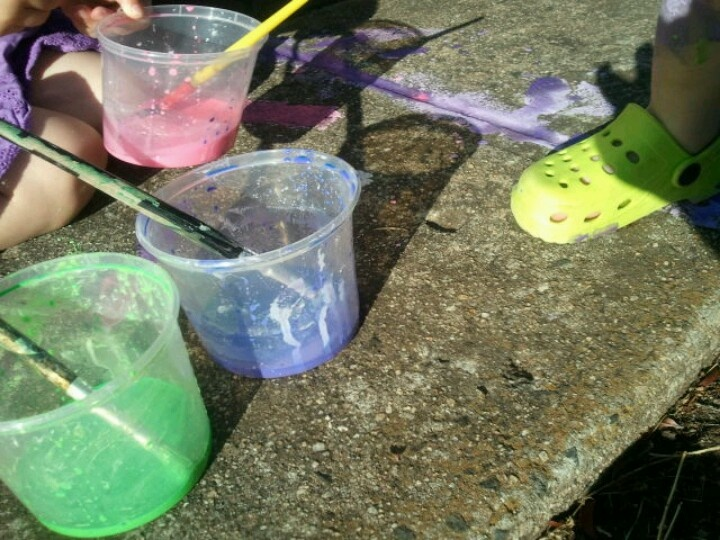 Corn flour, water and food colour to make a washable outside paint.